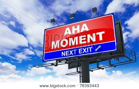 Aha Moment on Red Billboard.