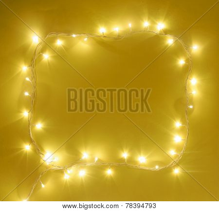 A border made with xmas lights. Space for text and headline.