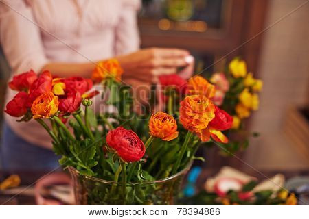 Fresh flowers with buds of bright color in floristics shop
