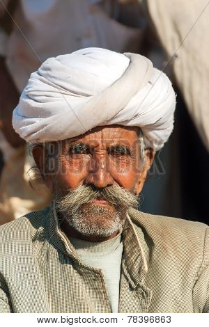 Old Cattle Farmer With White Turban.