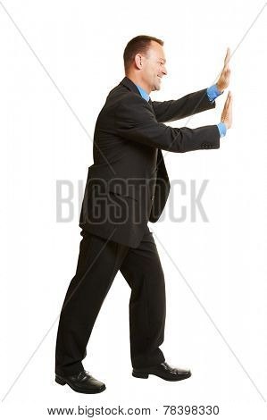 Isolated full body business man pushing imaginary wall