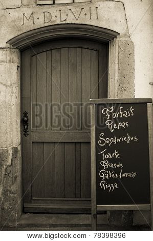 Menu board with old door in sepia