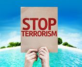 foto of terrorism  - Stop Terrorism card with a beach on background - JPG