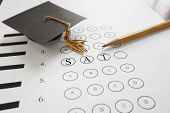 picture of guess  - SAT test with pencil and mortar board graduation cap - JPG