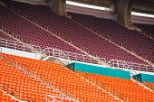pic of bleachers  - red seats on the stadium steps bleacher - JPG