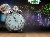 picture of count down  - Alarm clock counting down to twelve against wooden planks - JPG