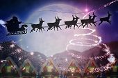 picture of quaint  - Silhouette of santa and reindeer against quaint town with bright moon - JPG