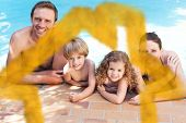 stock photo of swimming pool family  - Happy family beside the swimming pool against house outline in clouds - JPG