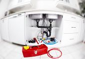 image of plumber  - Plumber tools on the kitchen - JPG
