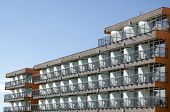 stock photo of row houses  - Rows of balconies in a new apartment house - JPG