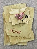 Постер, плакат: Antique paper love letters and envelopes with red heart and iron key