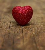 stock photo of heartfelt  - Red heart on a wood background  - JPG