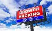 picture of hack  - Growth Hacking Inscription on Red Billboard on Sky Background - JPG