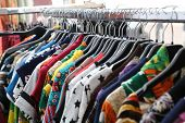 picture of flea  - set of vintage clothes of many colors at flea market - JPG