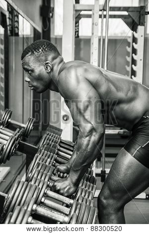 Handsome black male bodybuilder resting after workout