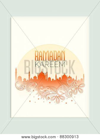 Beautiful greeting card decorated with Mosque and floral pattern for holy month of Muslim community Ramadan Kareem celebration.