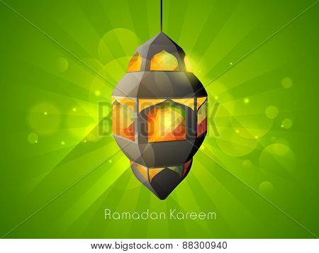 Creative illuminated Arabic lamp hanging on shiny green background for holy month of Muslim community, Ramadan Kareem celebration.