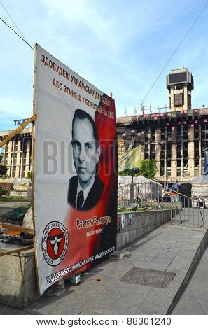 KIEV, UKRAINE - Mar 24, 2014: Stephan Bandera poster (Ukrainian nationalist icon ) near Burnt down the House of trade unions.March 24, 2014 Kiev, Ukraine