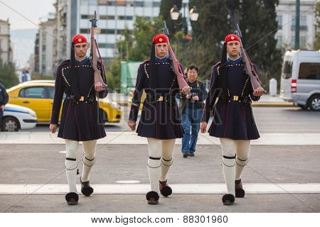 ATHENS, GREECE - APR 14, 2015: Greek soldiers Evzones (or Evzoni) dressed in service uniform, refers to the members of the Presidential Guard, an elite ceremonial unit, active from 1833 - present.