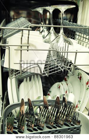 Details Of Open Dishwasher With Clean Utensils