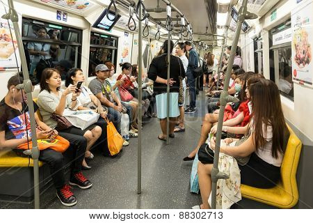 BANGKOK, THAILAND, JANUARY 12, 2015: Passengers inside in the Bangkok Mass Transit System (BTS) public train in Thailand