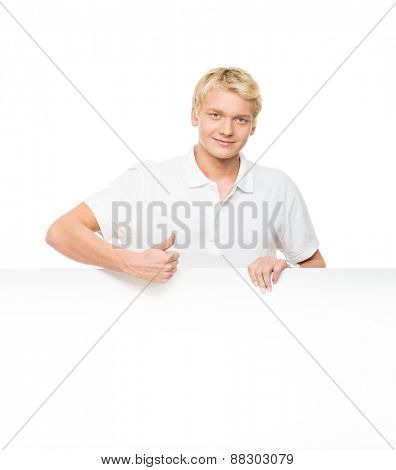 Young and handsome man holding a blank billboard isolated on white
