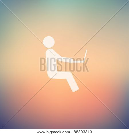 Man sitting with laptop icon in flat style for web and mobile, modern minimalistic flat design. Vector white icon on gradient mesh background