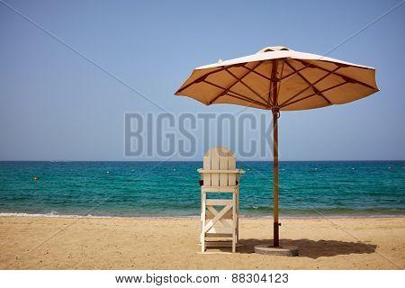 A lifeguard's chair on the beach.