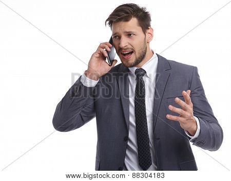 Businessman nervously talking on the phone