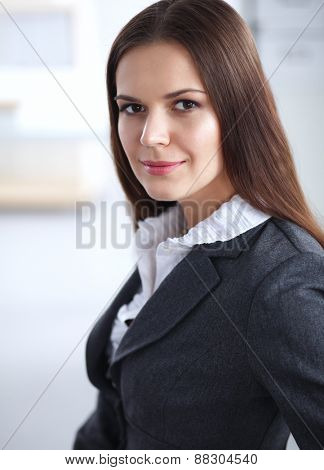 Attractive businesswoman sitting in the office .