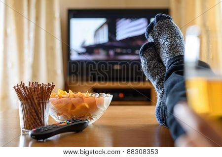 Television, Tv Watching (movie) With Feet On Table And Huge Amounts Of Snacks