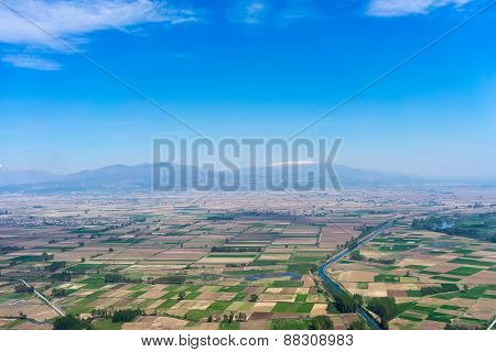 Aerial View Of A Green Rural Area Under Blue Sky At The North Greece