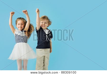 Happy little children on blue background