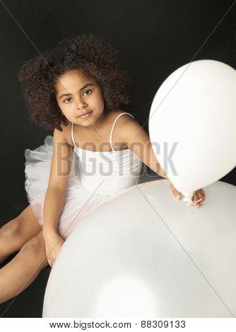 Cute mulatto girl holding balloon