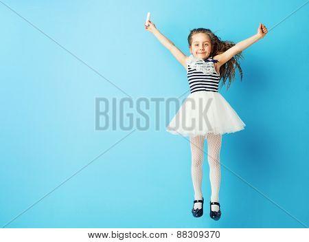 Girl drawing on blank chalkboard