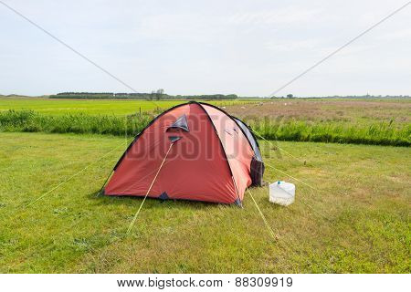 Single tent in the middle of the meadows