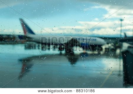 Plane at the airport. Bad weather, hurricane. Flight delays, transport collapse