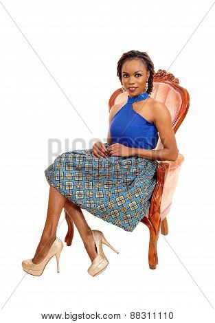 Gorgeous African Woman In Armchair.