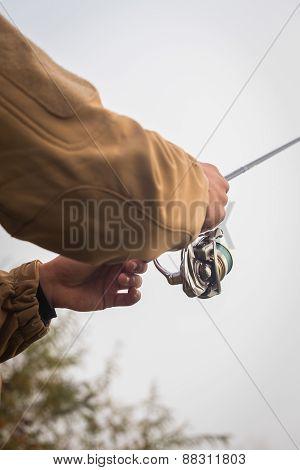 Fisherman on the autumn background