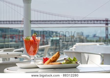 Samosa And Strawberry Juice With Bridge View On Background