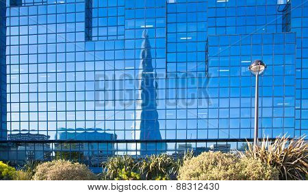 Reflection of Shard and blue sky in modern glass building City of London