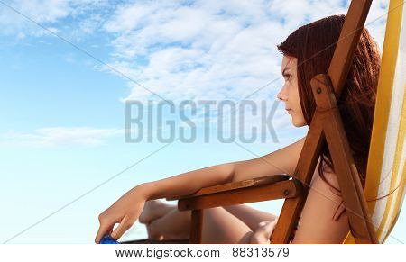 Woman At The Beach Sitting On Deckchairs