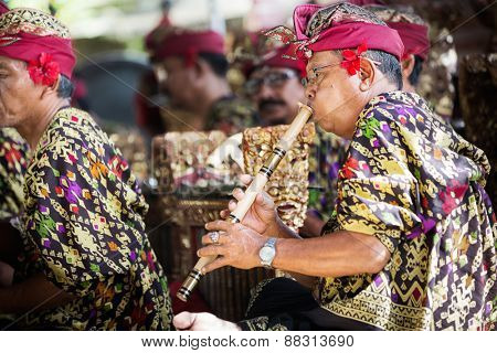 BALI, INDONESIA, DECEMBER, 24,2014: Musicians in the troupe play traditional Balinese music to accompany dancers in a 'Barong Dance show' in Ubud village on December 24, 2014 in Bali, Indonesia