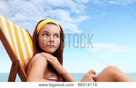 Woman Sitting At The Beach You Put The Sunscreen