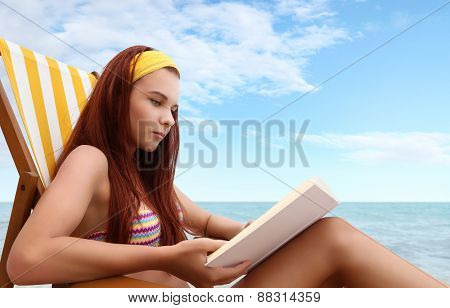 Woman At The Beach With A Book