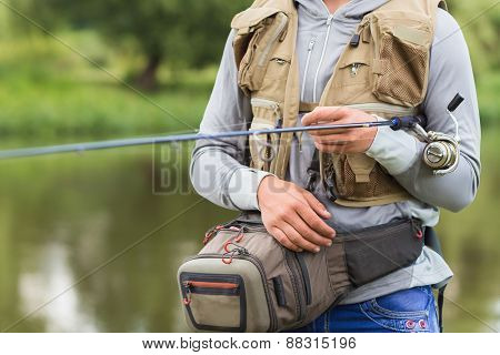 Fishing in river.A fisherman with a fishing rod on the river bank