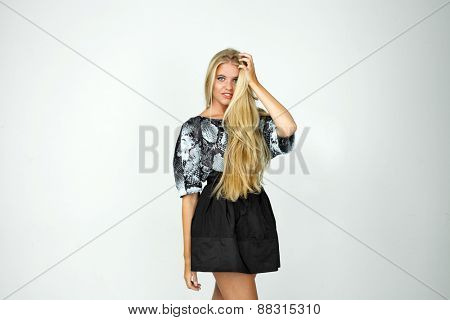 Happy blond girl in a black skirt and blouse