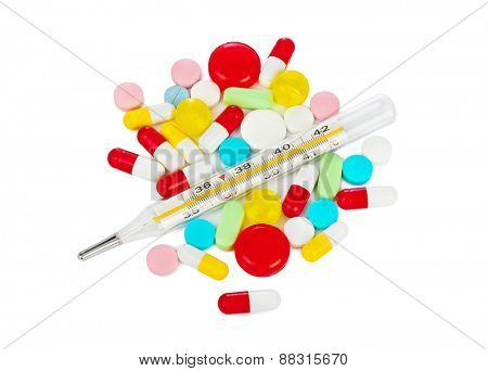 Pills and thermometer isolated on white background