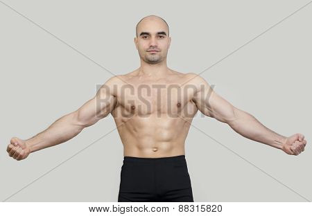 Fit Man Spreading Arms Showing His Body.