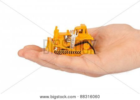 Hand with toy bulldozer isolated on white background
